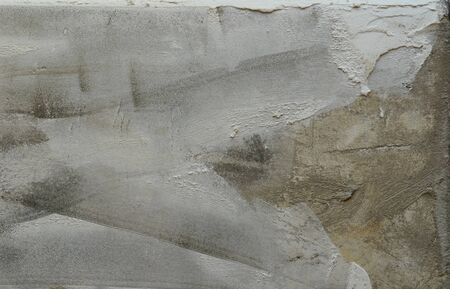 plastering: Dry plastering on wall. Grey background for masonry theme.