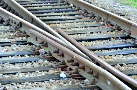 rail yard: Railroad line with railroad switch on gravel. Stock Photo