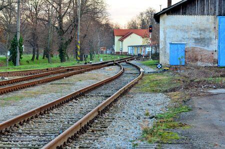 rail yard: Railroad line with railroad switch and train signal light.