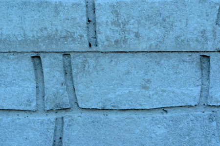gaps: Brick wall. Closeup with grey strong gaps.