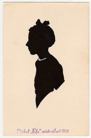 czechoslovak: THE CZECHOSLOVAK SOCIALIST REPUBLIC - 1950:  Vintage silhouette of girl. Text in Czech: Cut by Efo master of silhouettes 1950.
