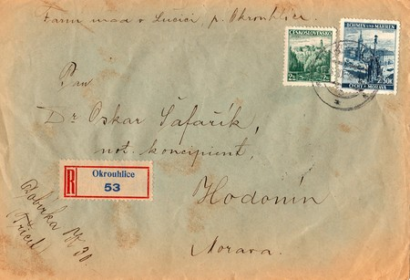 postmarked: PROTECTORATE OF BOHEMIA AND MORAVIA - CIRCA 1939: A vintage used envelope and stamps. Rich stain and paper details. Can be used as background.