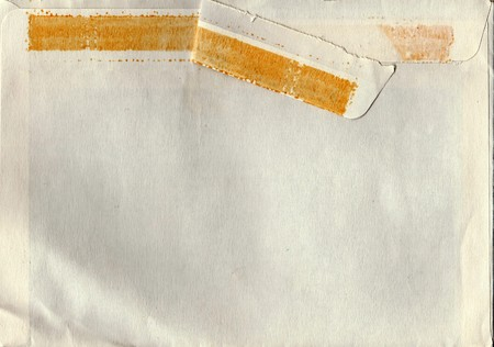 old envelope: Back of an old used envelope. Rich stain and paper details. Can be used as background.