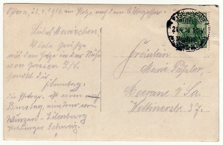 postcard back: GERMANY - APRIL 23, 1916: Back of a vintage photo - used postcard. Rich stain and paper details. Can be used as background. Image contains handwriting.