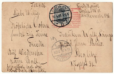 postcard back: BERLIN, GERMANY - APRIL 12, 1906: Back of a vintage photo - used postcard. Rich stain and paper details. Can be used as background. Image contains handwriting.