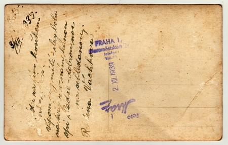 czechoslovak: PRAGUE, THE CZECHOSLOVAK  REPUBLIC - DECEMBER 3, 1939: Back of a vintage photo - used postcard. Rich stain and paper details. Can be used as background. Image contains handwriting. Editorial