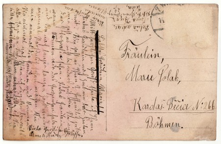 postcard back: WIEN, AUSTRIA - 1929: Back of a vintage photo - used postcard. Rich stain and paper details. Can be used as background. Image contains handwriting. Editorial