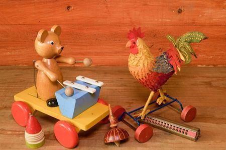 pull along: Pull toys and harmonica (mouth organ).  Vintage toy. Retro toys for boys and girls. Stock Photo