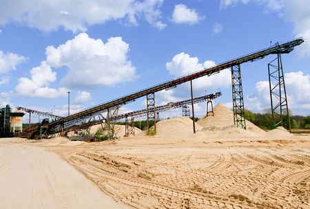 mine site: Conveyor belts and sand heaps. Construction industry. Sand quarry. Horizontal  photo.