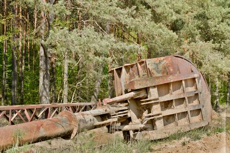 Abandoned industrial parts. Rusty metall equipment. Shovel of quarry crane. Strong HDR effect Stock Photo