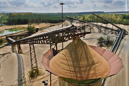 Quarry aggregate and conveyor belts. Construction industry. Horizontal  photo with HDR effect.