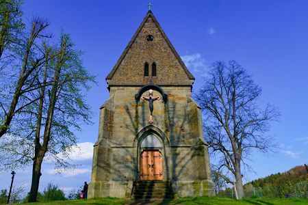 revelation: Christian church (kirk). Village Christian church with Jesus on the cross. Stock Photo