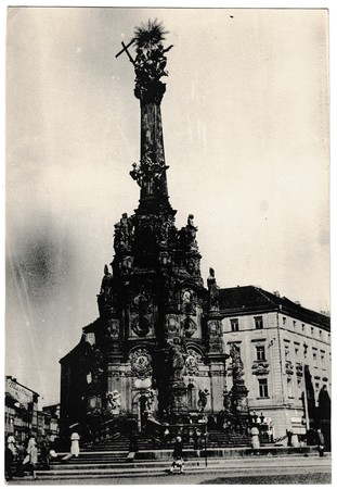 OLOMOUC, THE CZECHOSLOVAK SOCIALIST REPUBLIC -  CIRCA 1960s: Retro photo shows The Holy Trinity Column - the largest group of Baroque statues within a single sculptural monument in Central Europe. Black & white vintage photography. Stock Photo