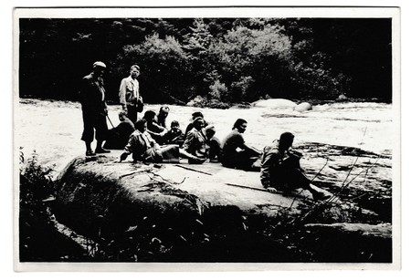 river: THE CZECHOSLOVAK SOCIALIST REPUBLIC -  JULY 4, 1954: Retro photo shows tourists have a rest on the bank of the river. Black & white vintage photography. Editorial