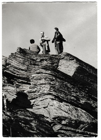 THE CZECHOSLOVAK SOCIALIST REPUBLIC - CIRCA 1980s: Retro photo shows tourists stand on top of the rock. People on holiday (vacation).  Black & white vintage photography Editorial