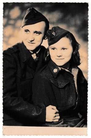 THE CZECHOSLOVAK SOCIALIST REPUBLIC - CIRCA 1940s: Retro photo shows soldiers (a pair of lovers).  Vintage black & white photography.