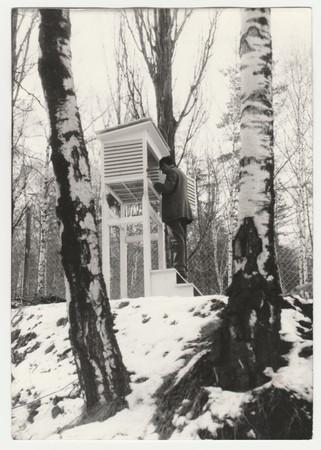 THE CZECHOSLOVAK SOCIALIST REPUBLIC - CIRCA 1950s: Retro photo shows meteorologist to control temperature. Vintage black & white photography.
