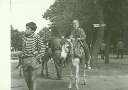 USSR - CIRCA 1970s: Retro photo shows boy rides on donkey in the park. Vintage black & white photography. Stock Photo - 80800865