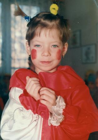 THE CZECHOSLOVAK SOCIALIST REPUBLIC - CIRCA 1980s:  Retro photo shows small girl wears funny costum. Vintage color photography.