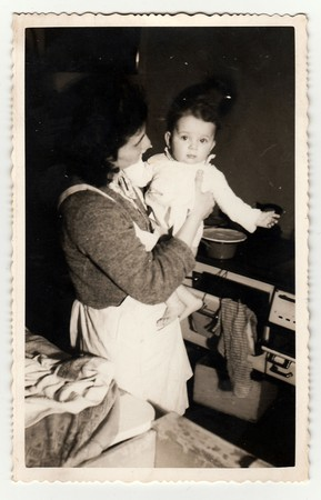 HODONIN, THE CZECHOSLOVAK REPUBLIC, CIRCA 1941: Vintage photo of a small girl with her mother, circa 1941.