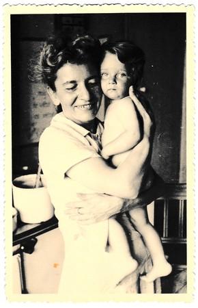 photo album: HODONIN, THE CZECHOSLOVAK REPUBLIC, CIRCA 1941: Vintage photo of mother and baby.  Photo with dark tint, circa 1941.