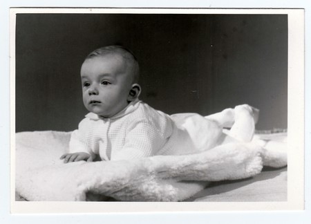 was: BRNO, THE CZECHOSLOVAK SOCIALIST REPUBLIC, MARCH 10, 1972: Retro photo of  baby boy (six months old).  Portrait photo was taken in photo studio on March 10, 1972. Editorial