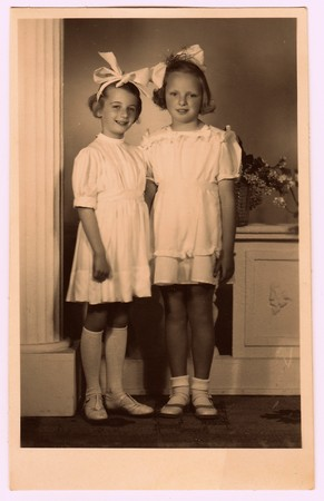 HODONIN, THE CZECHOSLOVAK REPUBLIC, CIRCA 1945: A vintage photo of the young girls - the first holy communion. Photo with colour tint, circa 1945.