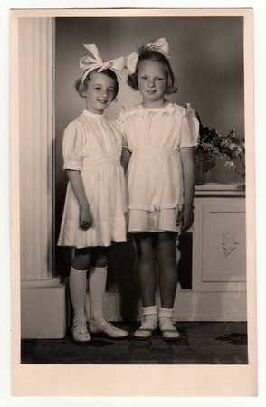 HODONIN, THE CZECHOSLOVAK REPUBLIC, CIRCA 1945: A vintage photo of the young girls - the first holy communion, circa 1945.