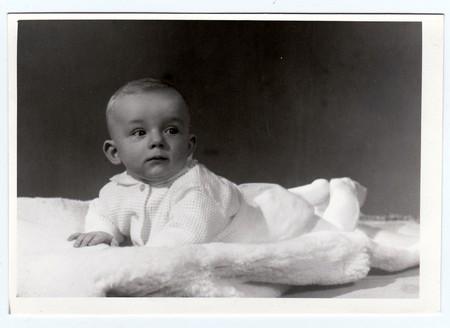 photo album: BRNO, THE CZECHOSLOVAK SOCIALIST REPUBLIC, MARCH 10, 1972: Retro photo of  baby boy (six months old).  Portrait photo was taken in photo studio on March 10, 1972. Editorial