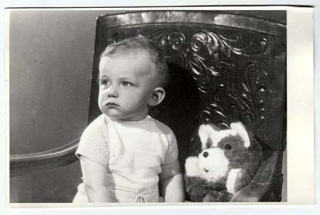 photo album: BRNO, THE CZECHOSLOVAK SOCIALIST REPUBLIC, CIRCA 1972: Retro photo of a small boy with teddy bear.  Portrait photo was taken in photo studio, circa 1972. Editorial