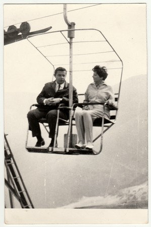 lipno: HUNGARY, 1970s: Retro photo of a marrital couple on a chair lift, 1970s. Editorial