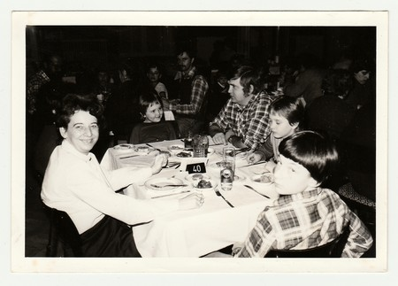 THE CZECHOSLOVAK SOCIALIST REPUBLIC, 1985: Vintage photo shows a group of people in the restaurant. Editorial