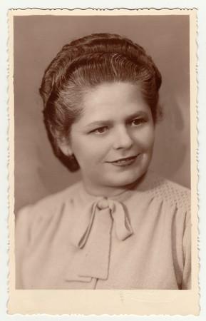 nad: ZABREH NAD ODROU, THE CZECHOSLOVAK REPUBLIC - CIRCA 1940s: Vintage photo of a young woman