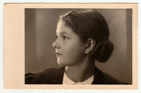 THE CZECHOSLOVAK REPUBLIC - DECEMBER 20, 1936: Vintage portrait of a young woman