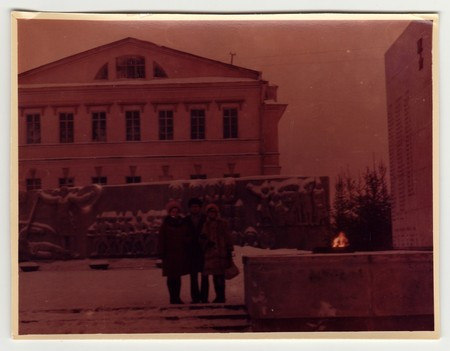 USSR - CIRCA 1970s: Vintage photo shows people pose on the street in winter. Photo is under exposed.