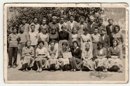 THE CZECHOSLOVAK  SOCIALIST REPUBLIC - 1961: A vintage photo shows schoolmates with female teacher.