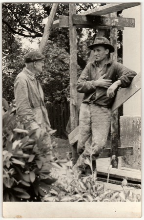 THE CZECHOSLOVAK SOCIALIST REPUBLIC - CIRCA 1970:  Vintage photo shows bricklayers. Black & white photo shows wooden scaffolding.