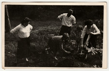THE CZECHOSLOVAK  SOCIALIST REPUBLIC - CIRCA 1960: A vintage photo shows family outdoors.