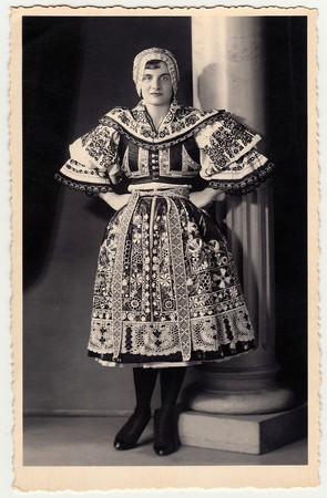 HODONIN, THE CZECHOSLOVAK REPUBLIC - CIRCA 1920s: Vintage photo shows woman in a folk costum.