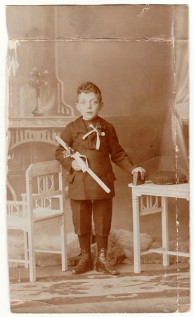 HODONIN,  AUSTRIA-HUNGARY - CIRCA 1910s:  A vintage photo shows young boy - the first holy communion. Antique black & white photo with sepia tint.