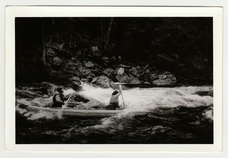 THE CZECHOSLOVAK SOCIALIST REPUBLIC - CIRCA 1980s: Vintage photo shows young canoeists on the river.