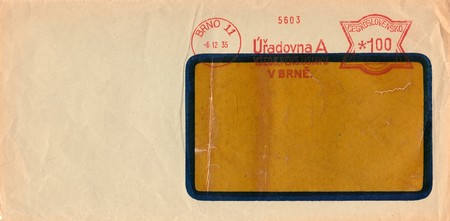THE CZECHOSLOVAK REPUBLIC - DECEMBER 6, 1935: A vintage used envelope and stamp. Rich stain and paper details. Can be used as background. Editorial