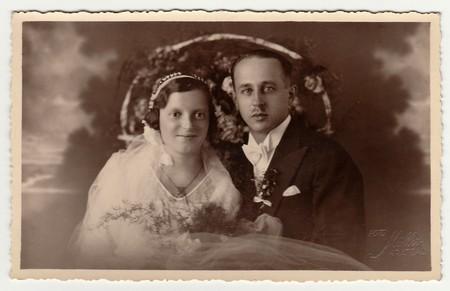 CHRASTAVA (KRATZAU), THE CZECHOSLOVAK  REPUBLIC - CIRCA 1930s: Vintage photo of newlyweds. Black & white antique studio portrait.