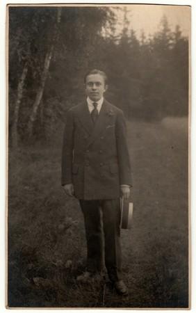 THE CZECHOSLOVAK REPUBLIC - CIRCA 1920s: Vintage photo shows man holds wide-brimmed hat. Antique black & white photo.