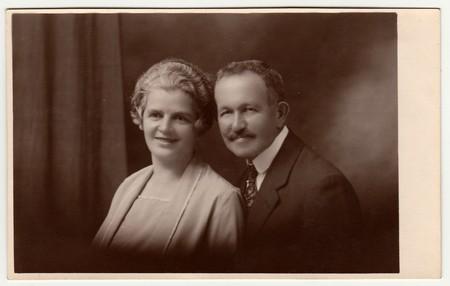 LIBEREC (REICHENBERG), THE CZECHOSLOVAK  REPUBLIC - CIRCA 1930s: Vintage photo shows a mature couple. Black & white antique studio portrait. Sepia tone
