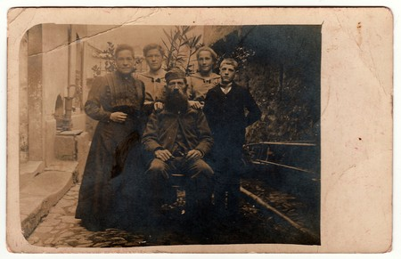 RUSSIA - CIRCA 1920s: Vintage photo shows rural family poses outdoors. Black & white antique photography.