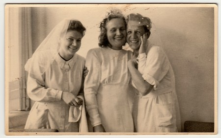 dispensary: THE CZECHOSLOVAK  REPUBLIC - CIRCA 1930s: Vintage photo shows nurses, one of them prepares to wedding ceremony . Black & white antique photography. Editorial