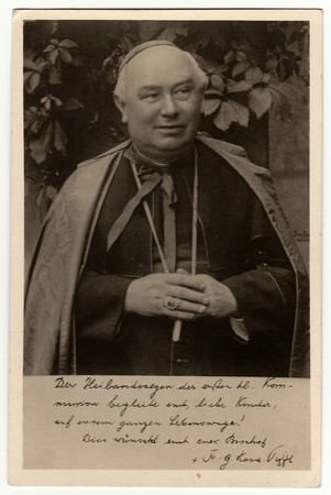 GERMANY - CIRCA 1950s: Vintage photo shows a catholic priest. Black & white antique photography. Editorial