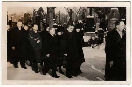 THE CZECHOSLOVAK REPUBLIC - CIRCA 1940s: Vintage photo shows people during funeral. Black & white antique photo.
