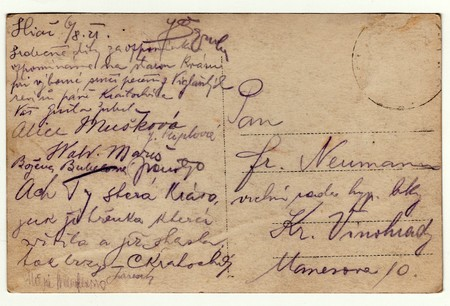 SLIAC, THE CZECHOSLOVAK REPUBLIC - AUGUST 6, 1921: Back of a vintage photo - used postcard. Rich stain and paper details. Can be used as background. Image contains handwriting.